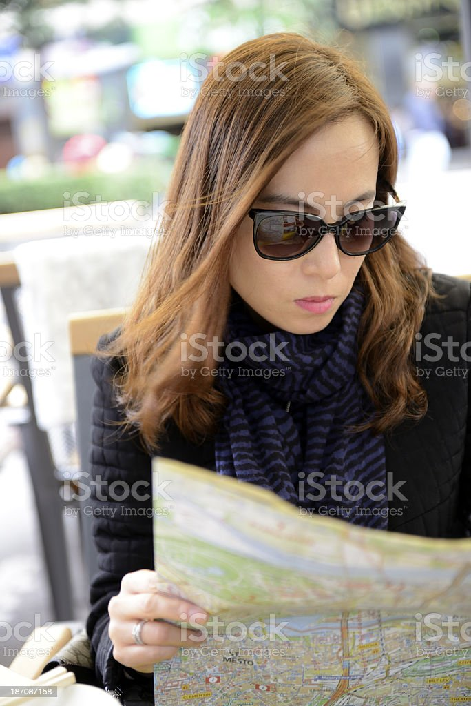 Female tourist reading a map royalty-free stock photo