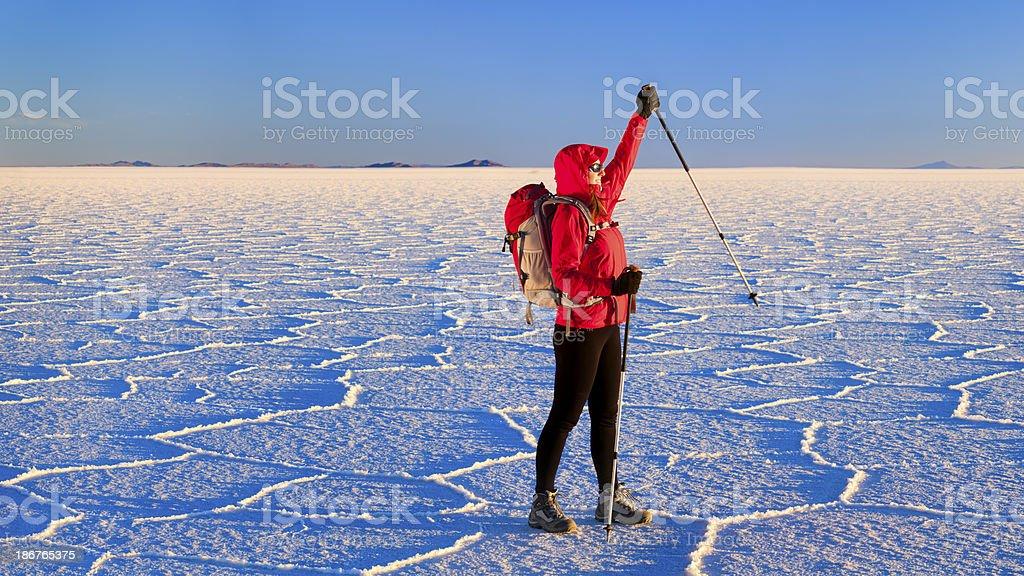 Female tourist standing on Salar de Uyuni, Altiplano Bolivia stock photo