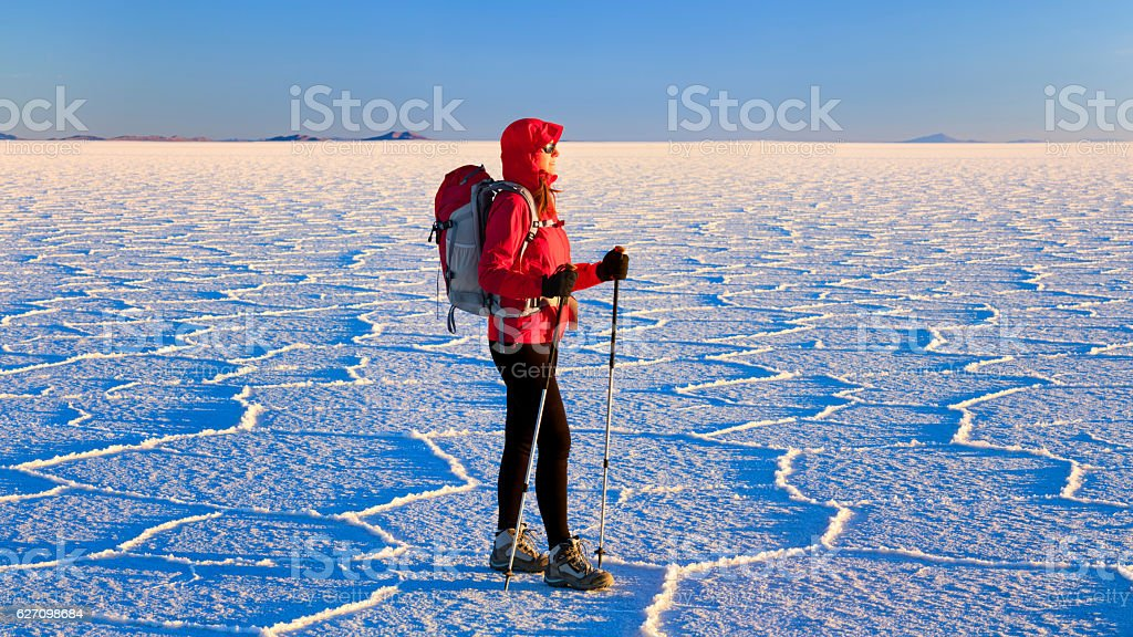 Female tourist standing on Salar de Uyuni, Altiplano Bolivia stock photo