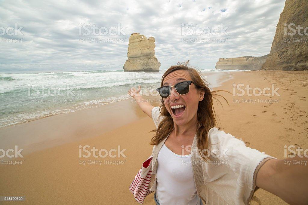 Female tourist takes selfie portrait at the Twelve apostles stock photo
