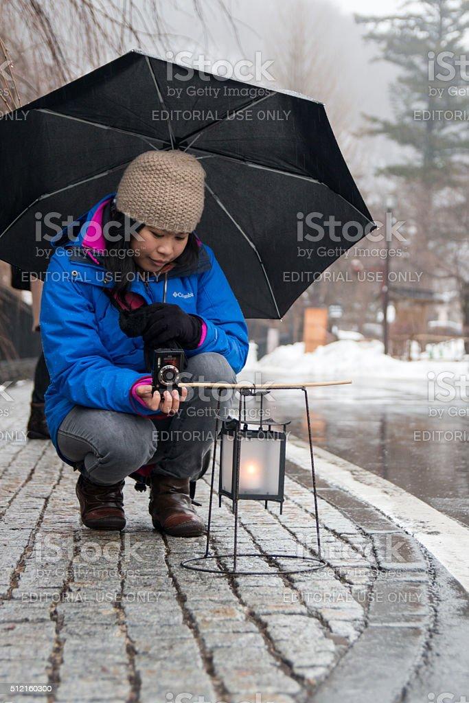 Female Tourist Taking a Picture of a Lantern stock photo