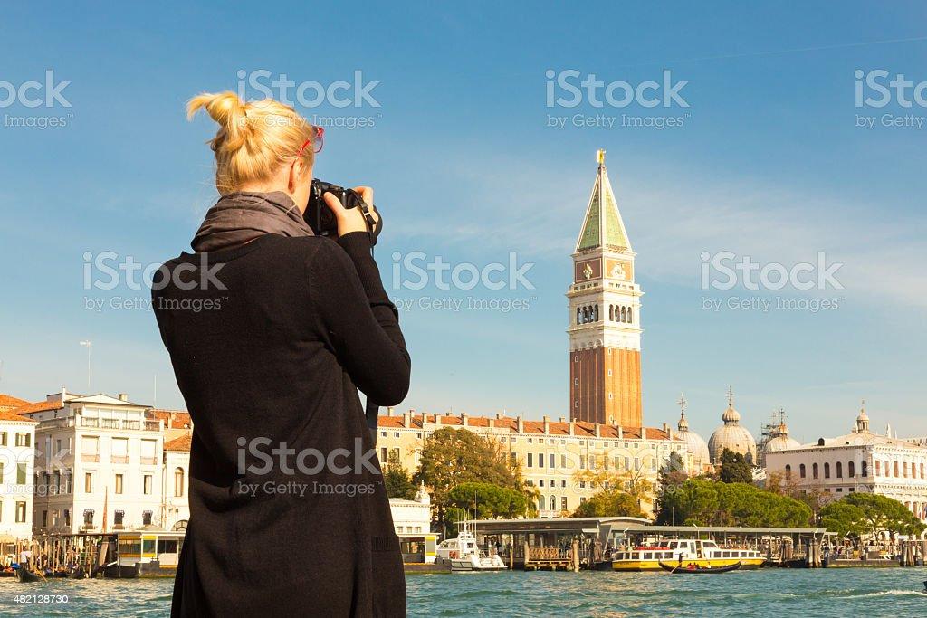 Female tourist taking photo of Venice. stock photo