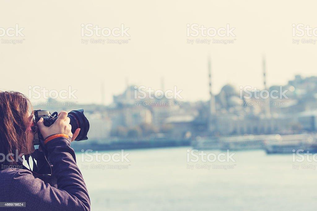 Female tourist taking photos in Istanbul Turkey stock photo