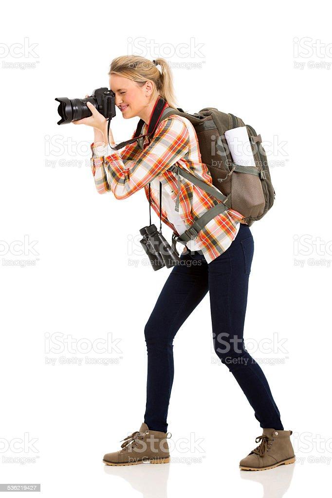 female tourist taking photos stock photo