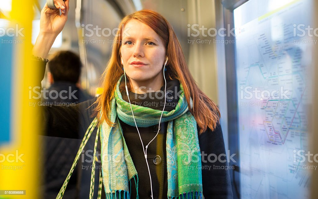 Female tourist traveling by train stock photo