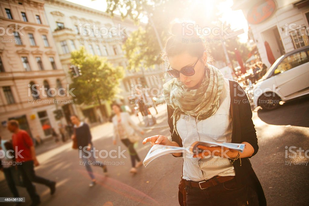 Female tourist walking on the street in Berlin stock photo