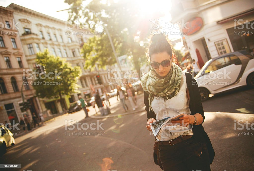 Female tourist walking on the street in Berlin stock photo