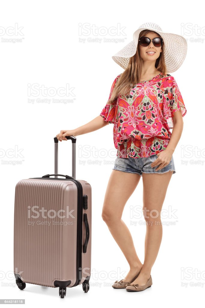 Female tourist with a suitcase stock photo