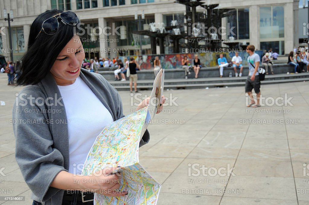 female tourist with city map at Alexanderplatz Berlin Mitte (Germany) royalty-free stock photo