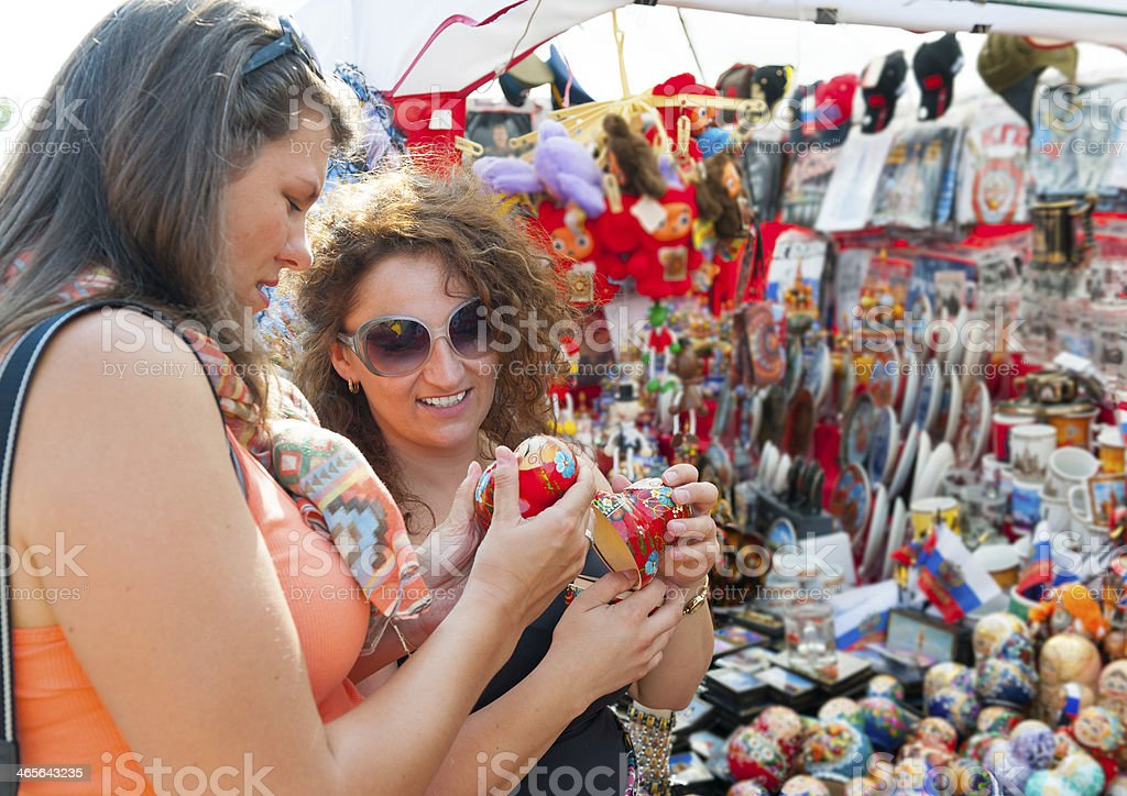 Female tourists choosing souvenirs stock photo