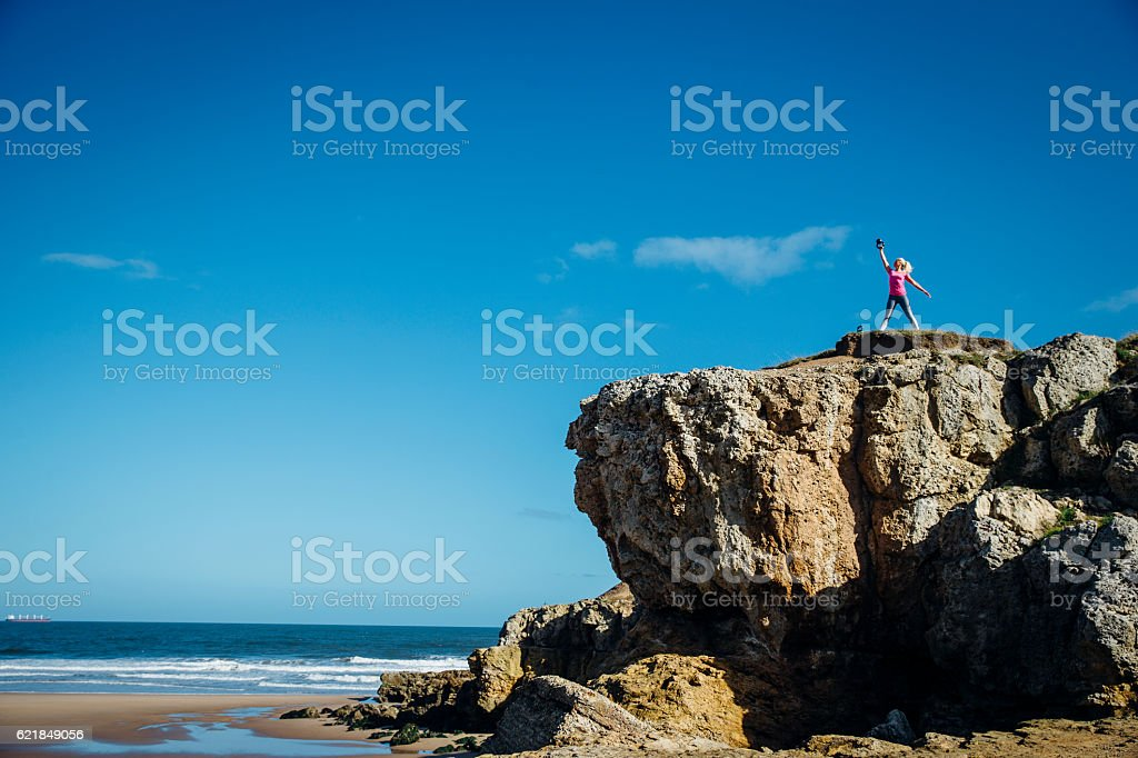 Female Training on to of a Rock stock photo