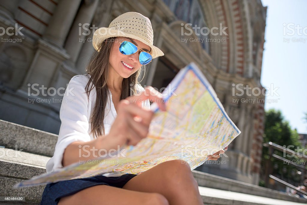Female traveler looking at a map stock photo