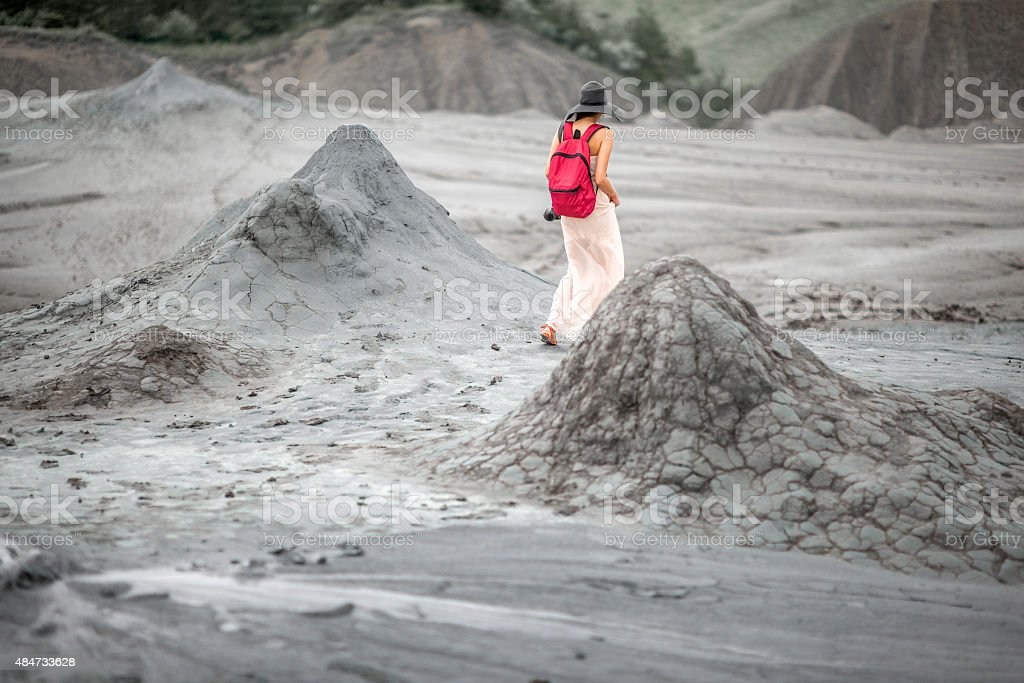 Female traveler walking near mud volcanoes stock photo