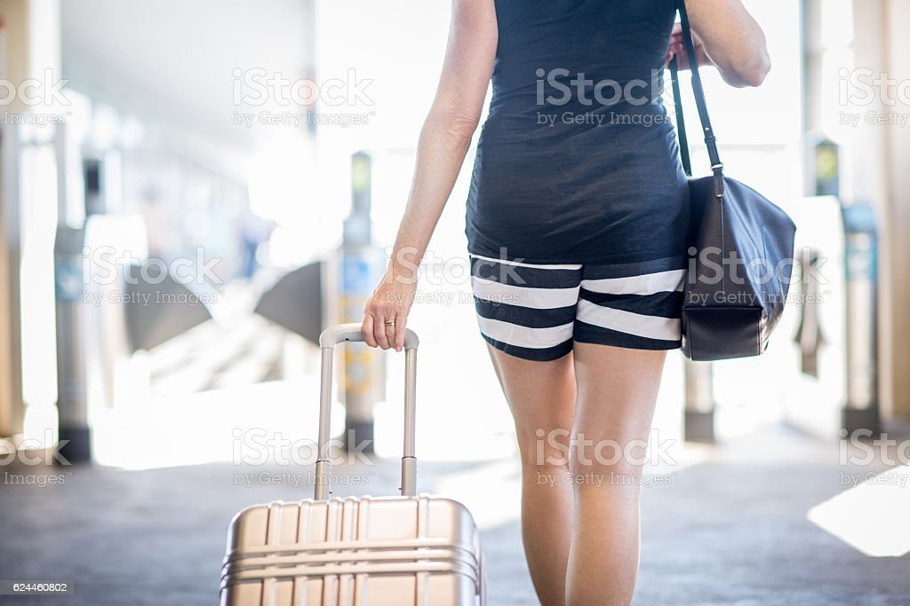 Female Traveling Alone with Suitcase stock photo