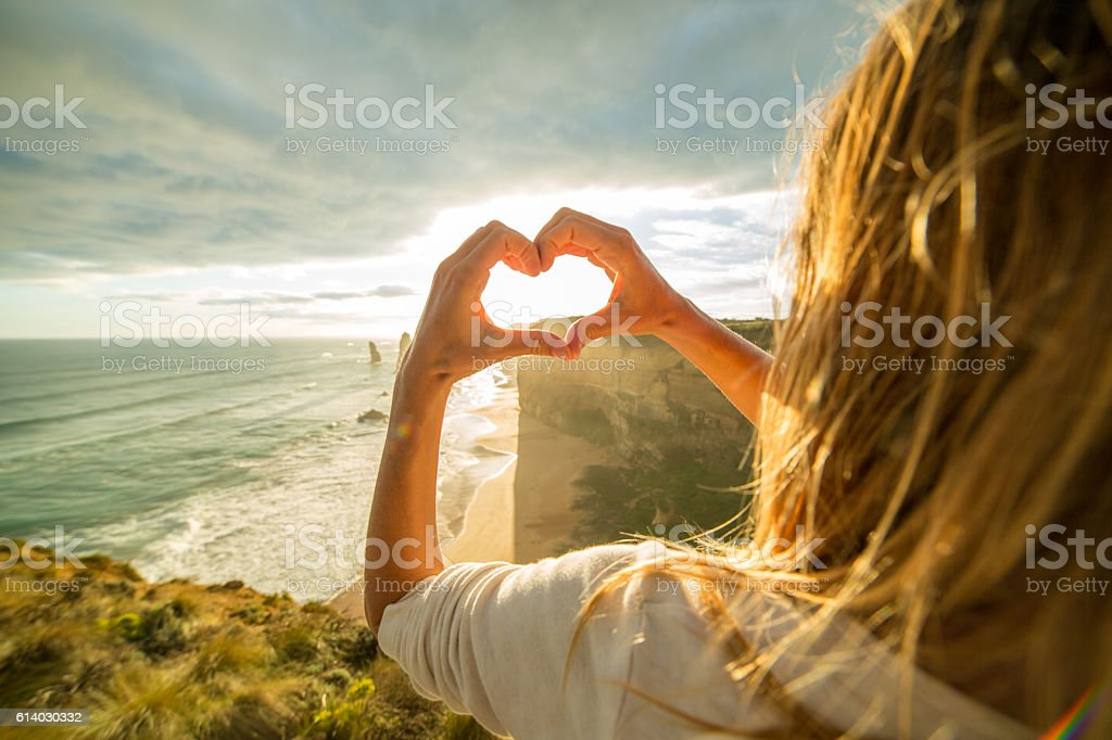 Female traveling loves the Twelve Apostles, Australia stock photo