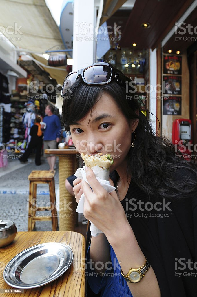 Female Traveller At Snack Bar - XLarge royalty-free stock photo