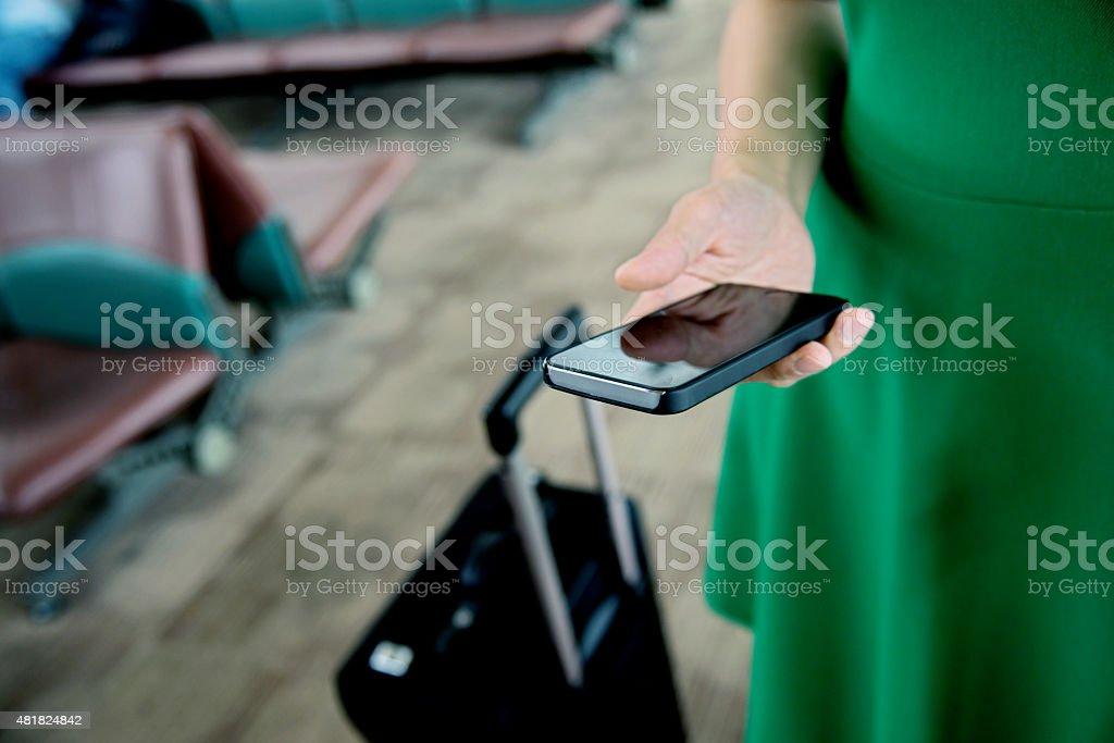 Female traveller using smartphone stock photo