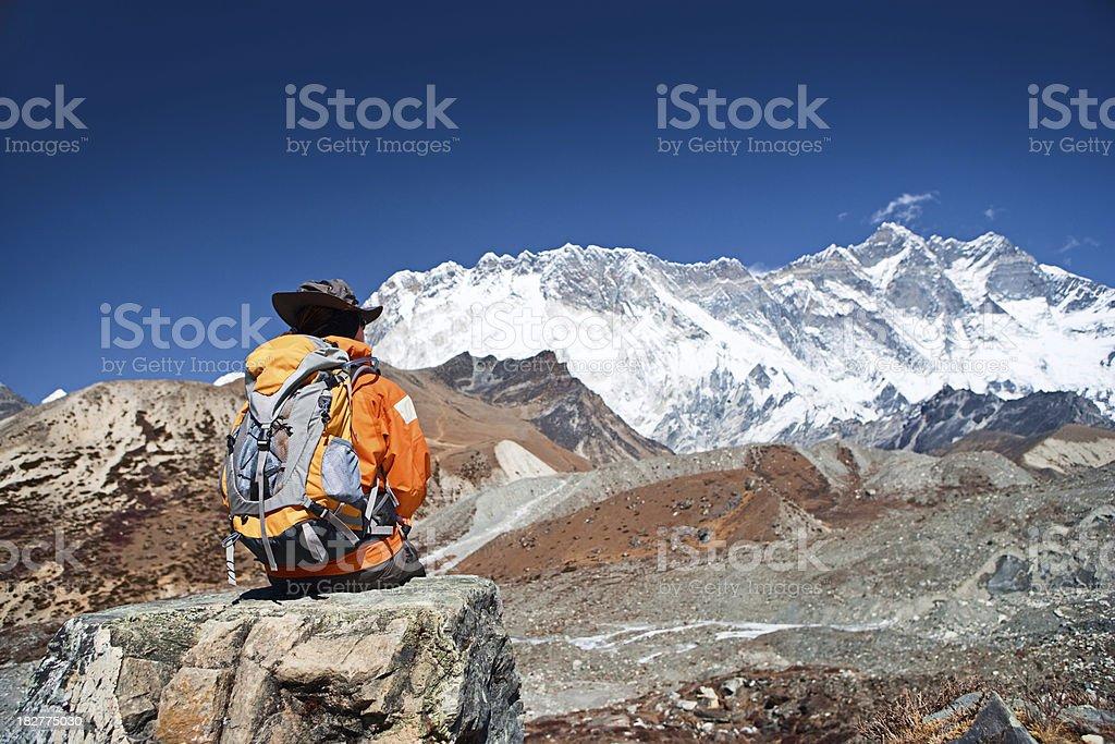 Female trekker looking at Lhotse, Sagarmatha National Park royalty-free stock photo