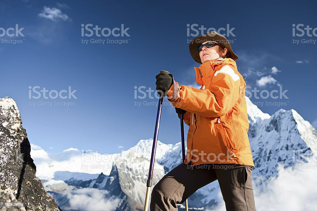 Female trekker looking over Himalayas royalty-free stock photo