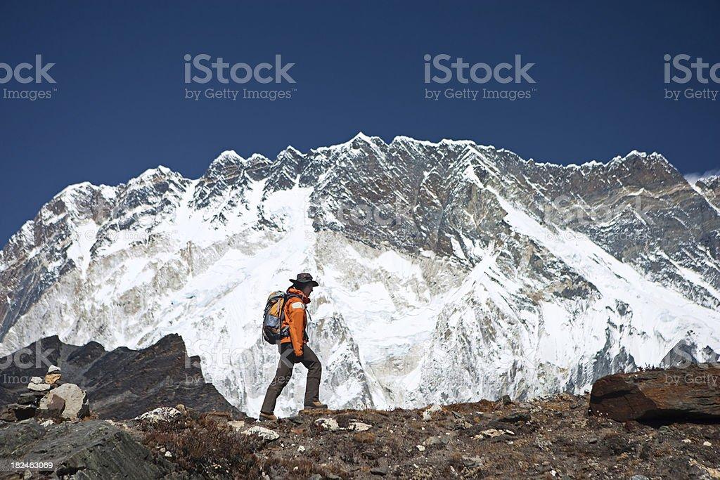 Female trekker on the background of Lhotse, Sagarmatha National Park royalty-free stock photo