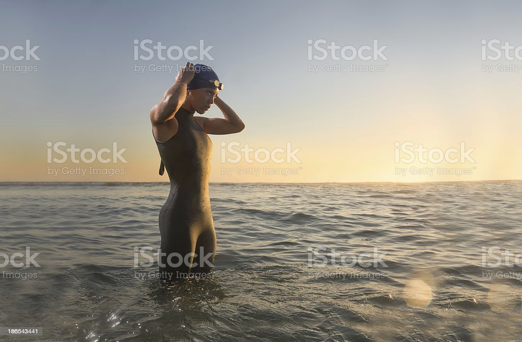 Female Triathlon Athlete at Sunrise stock photo