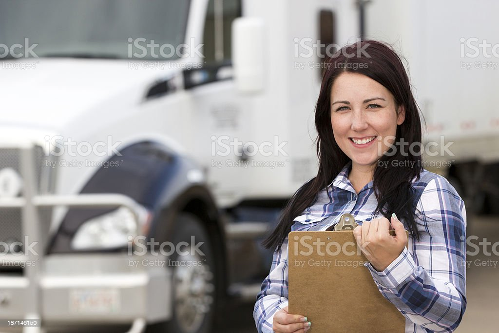 Female Truck Driver and Clipboard stock photo