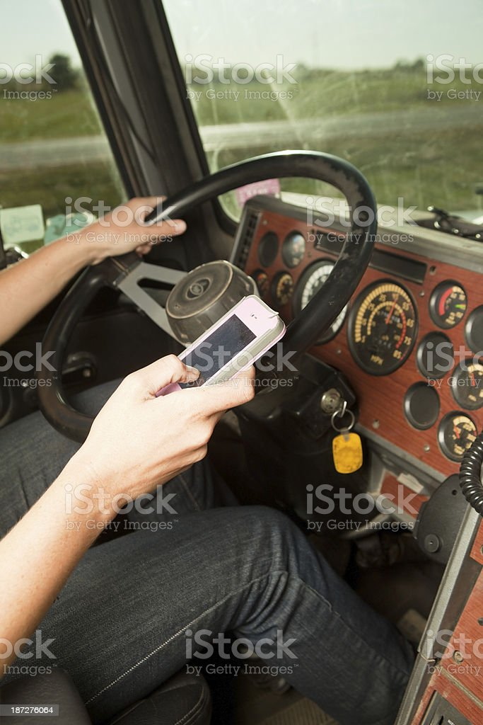 Female Truck Driver Texting while Driving royalty-free stock photo