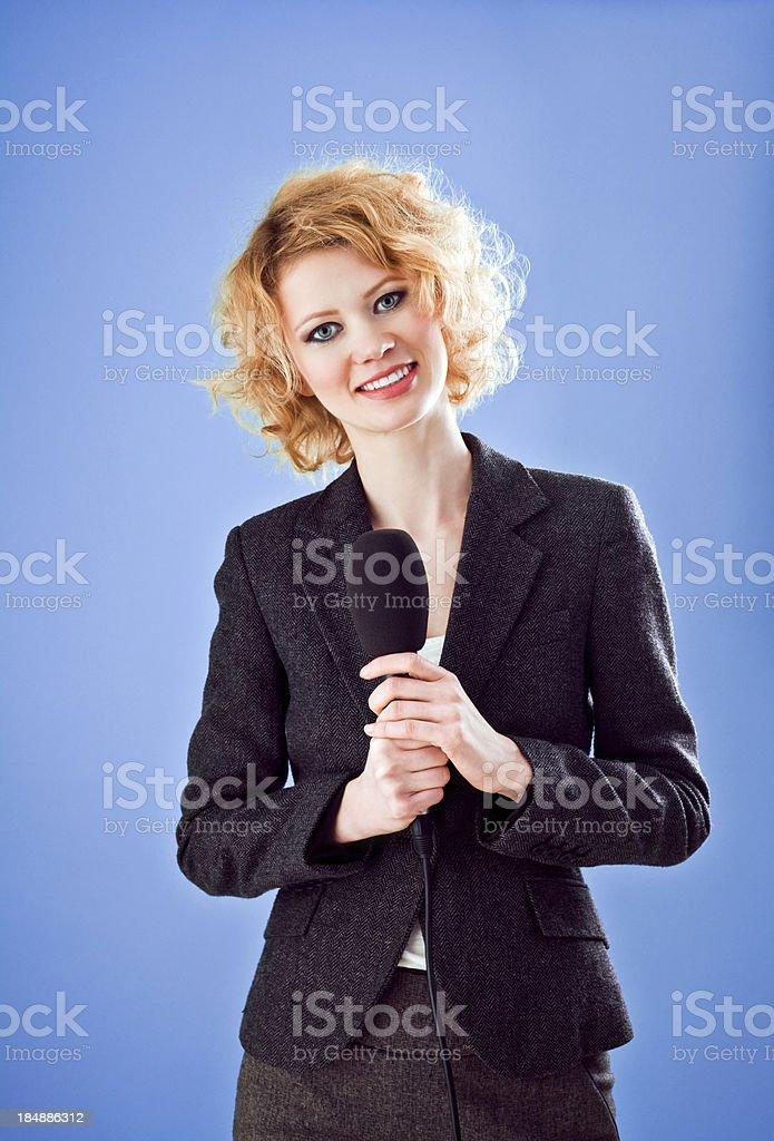 Female TV Reporter, Studio Shot stock photo
