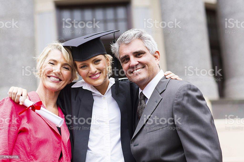 female university graduate and parents stock photo