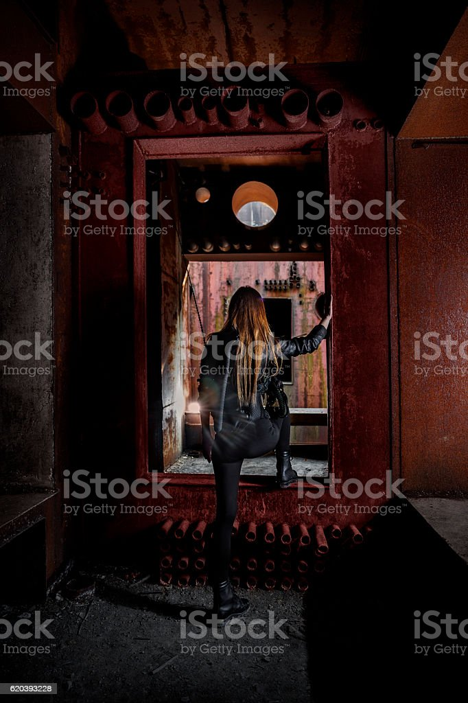 Female urban explorer in abandonned military bunker stock photo