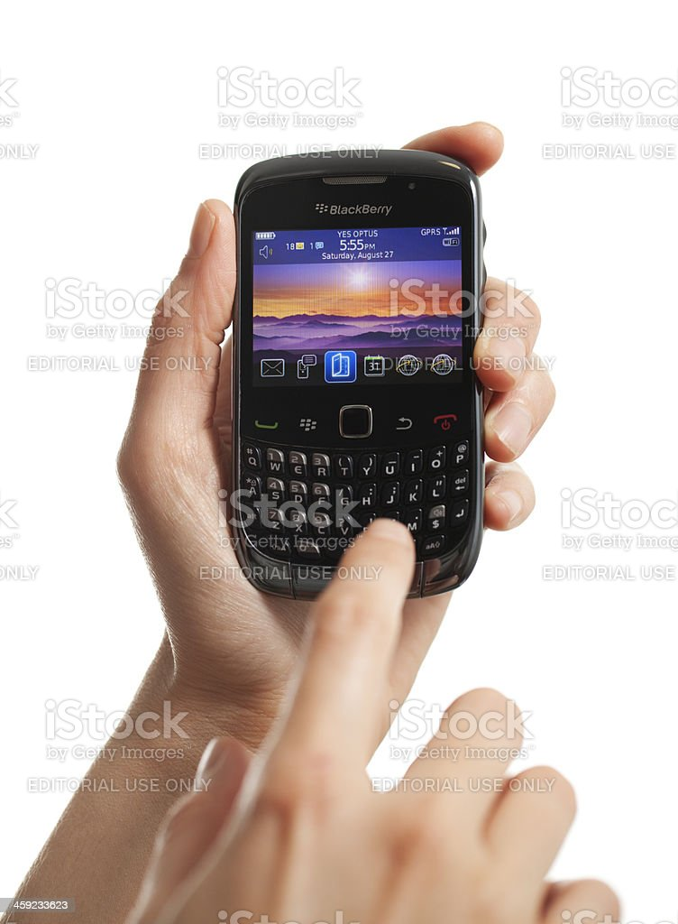Female Using BlackBerry Vertical royalty-free stock photo