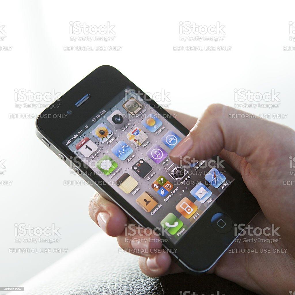 Female Using Iphone 4 royalty-free stock photo