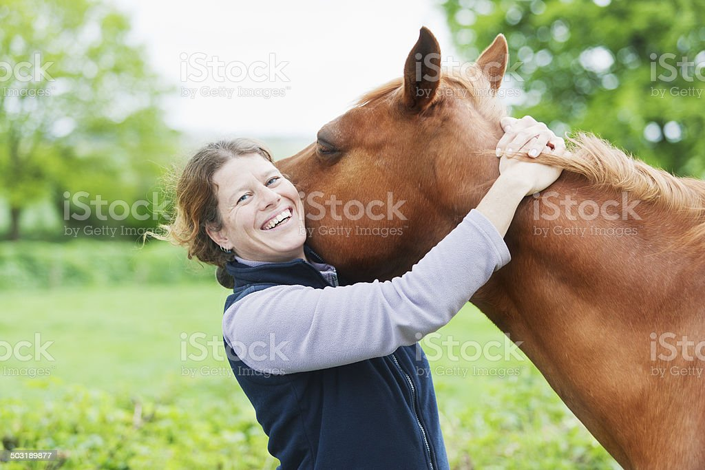 Female veterinarian with her horse royalty-free stock photo