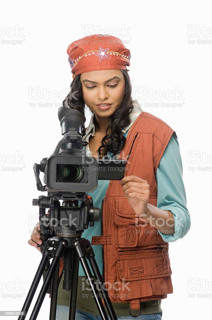 Female videographer video graphing stock photo