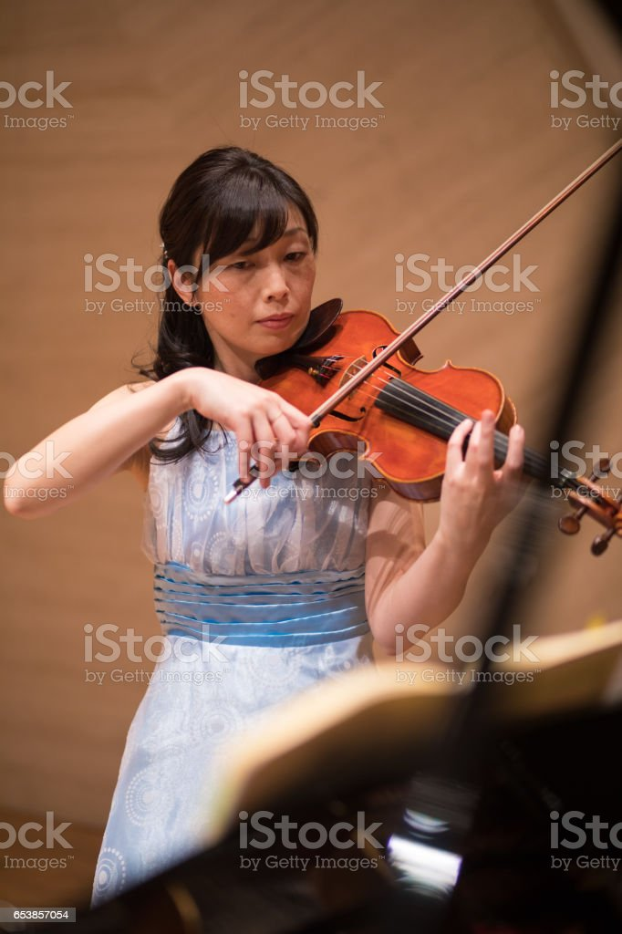 Female violinist playing before the concert stock photo