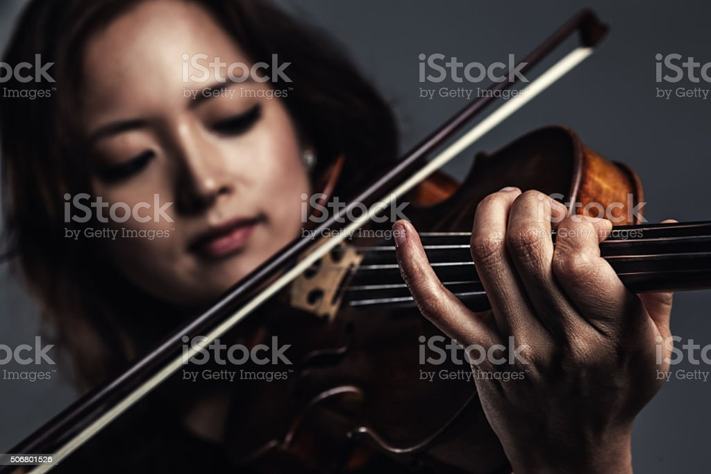 Female Violinist Playing Violin stock photo