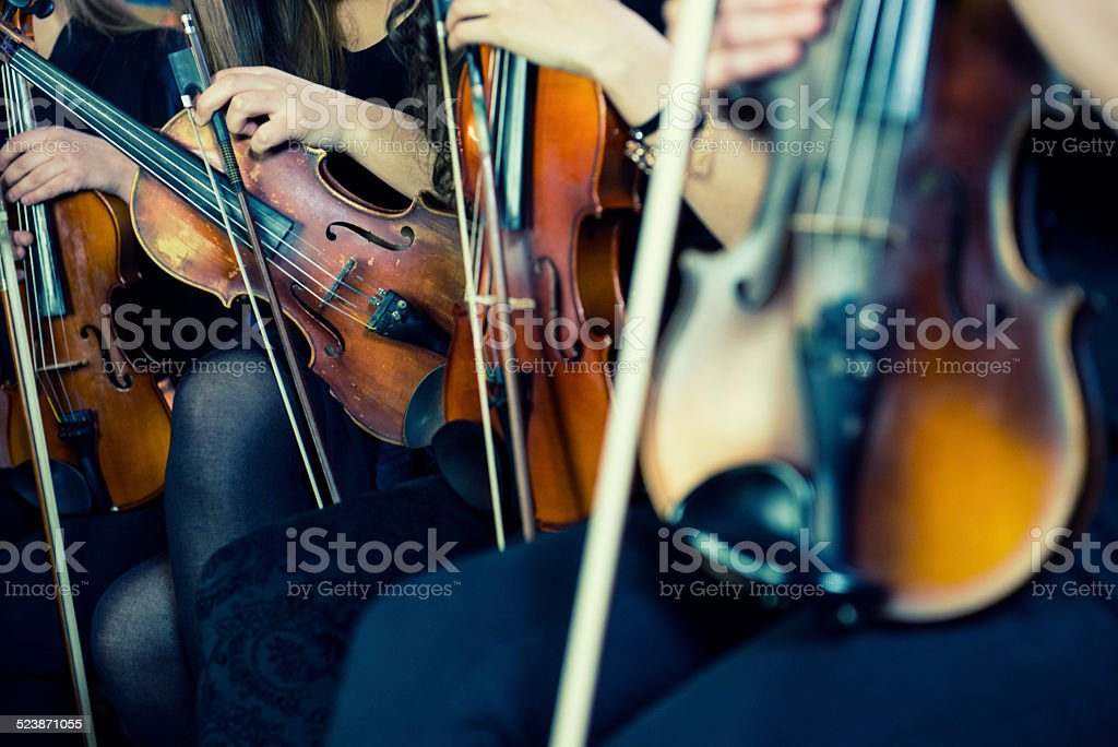Female Violinists Preparing for Classical Concert stock photo