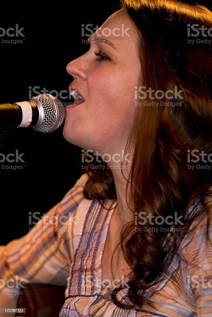 Female vocalist and mic. royalty-free stock photo