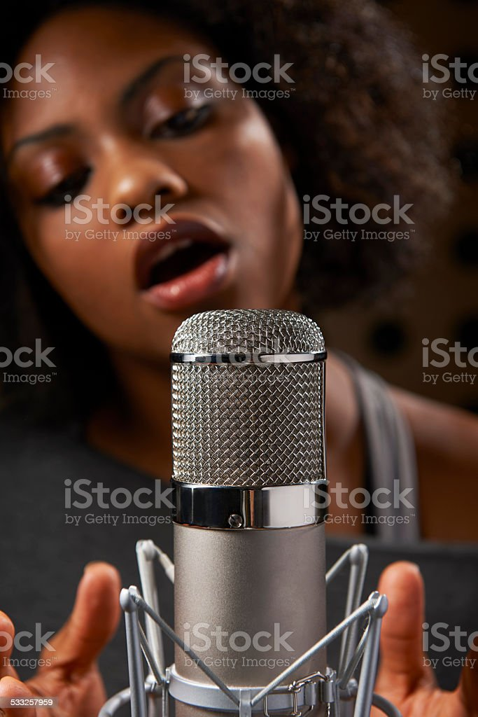 Female Vocalist In Recording Studio stock photo