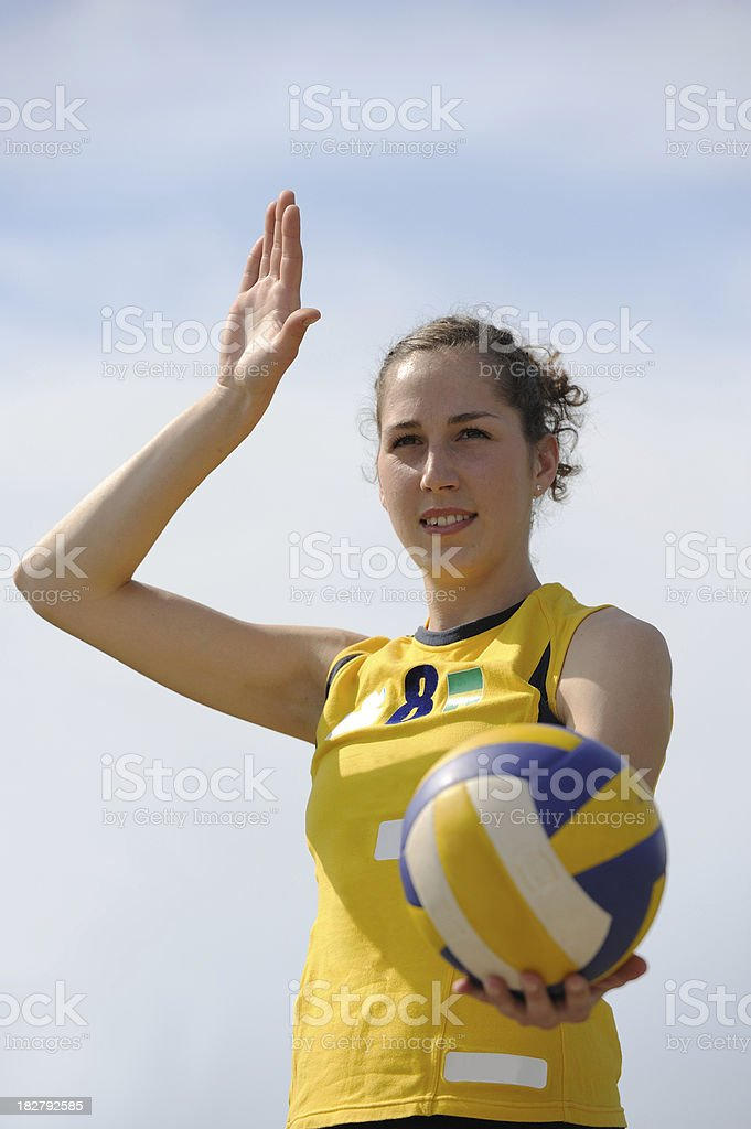 Female volleyball player concentrating for serve royalty-free stock photo