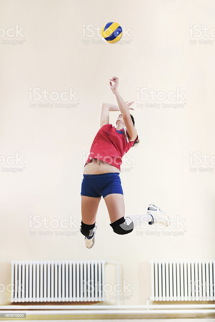 Female volleyball player in action. stock photo