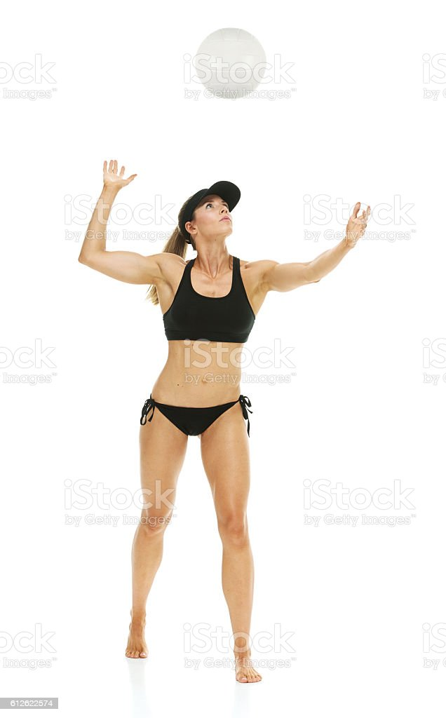 Female volleyball player serving the ball stock photo