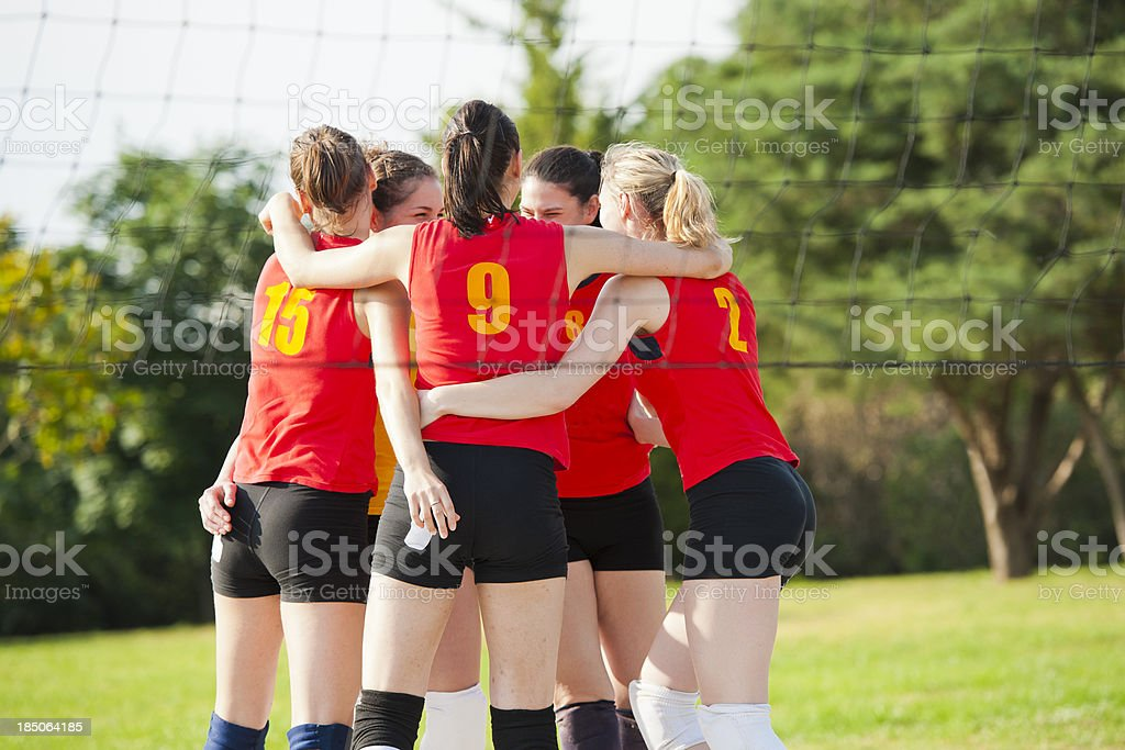 Female volleyball players celebrating after the winning point royalty-free stock photo