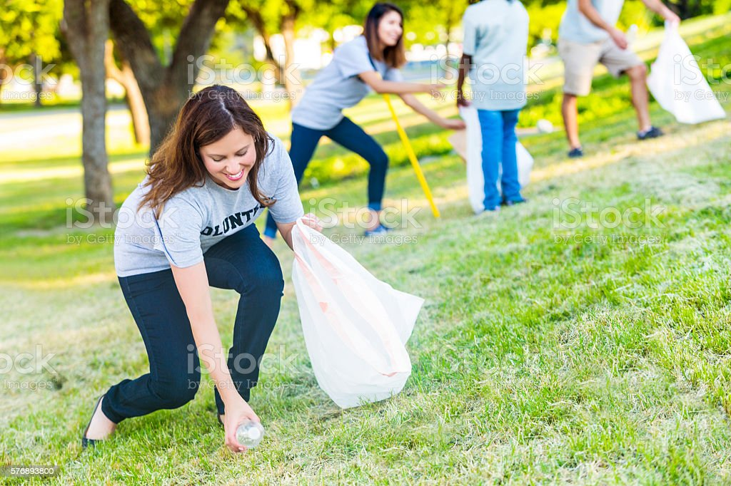 Female volunteer helps with park beautification stock photo