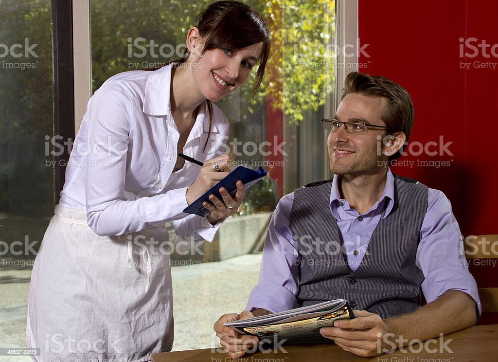 Female Waitress Taking an Order from the Male Customer royalty-free stock photo