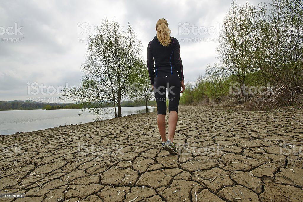 Female walking and running by the water stock photo