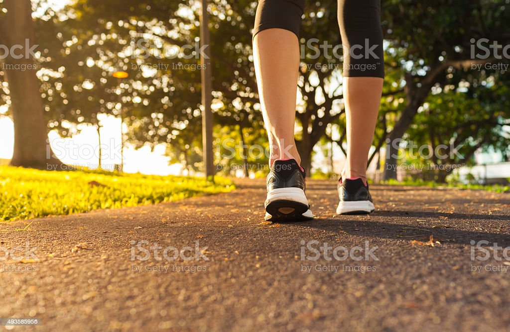 Female walking in the park stock photo