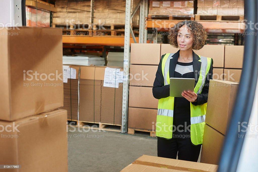 female warehouse manager stock photo