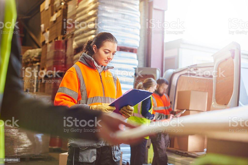 female warehouse worker stock photo