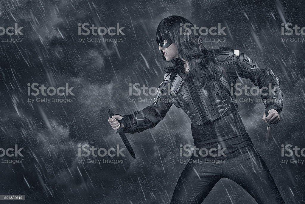 Female Warrior in bad weather stock photo